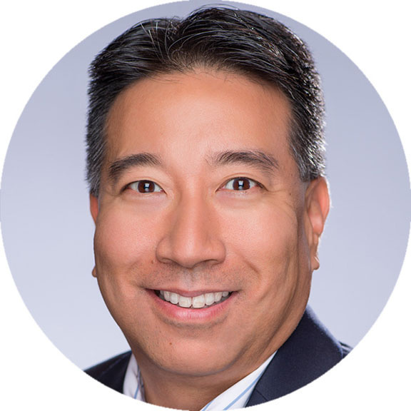 Headshot of Legrand North and Central America VP of Strategic Sourcing & Purchasing Steve Liu, in front of a blue grey background