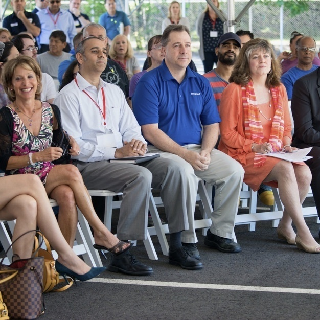 Image of Legrand employees sitting in chairs at a seminar