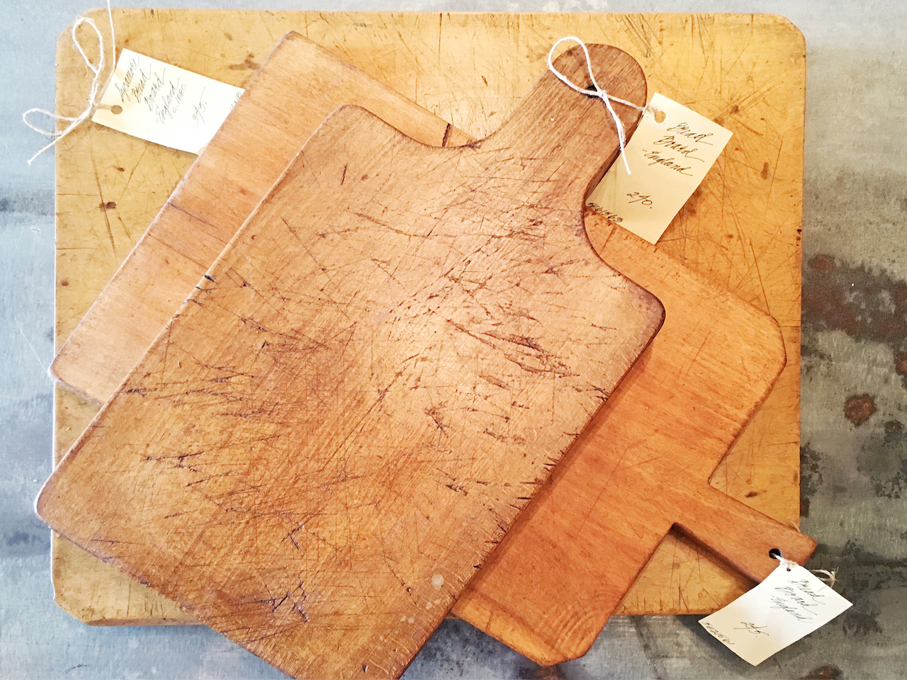 Antique cutting boards, ranging in price from $245 to $345, at Henhouse Antiques