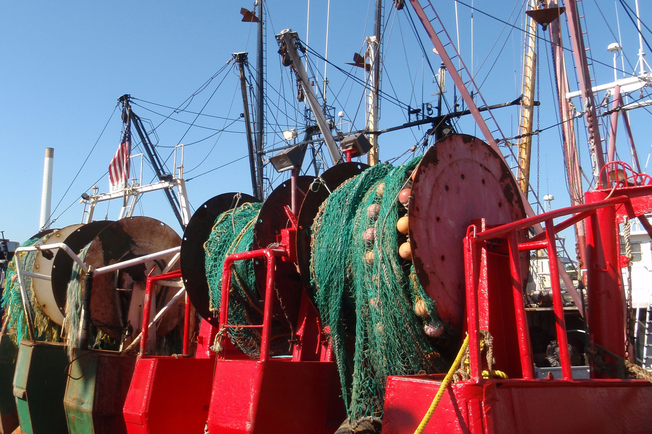 Stern trawl with drum filled with gear at commercial fishing dock.