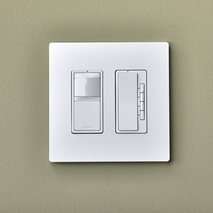White two-gang dimmer switch and sensor installed on taupe wall with screwless wallplate