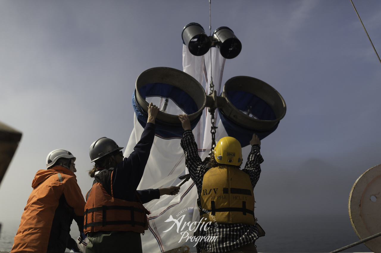 Crew hoisting survey nets.