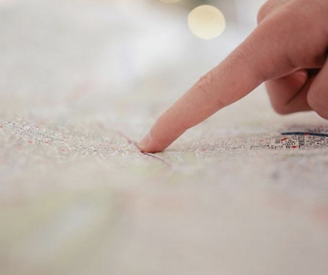 Person pointing to map