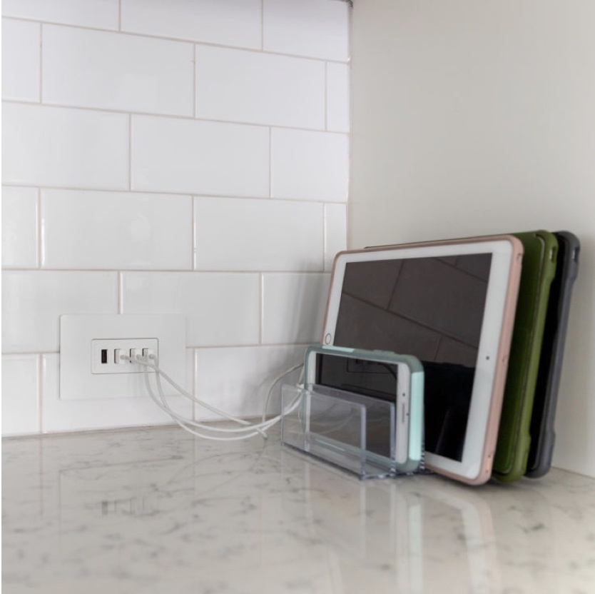 radiant Collection by Legrand Quad USB outlet with multiple smart devices charging on counter top