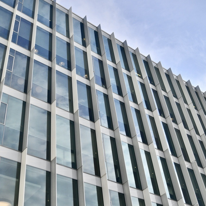 Large windows on the exterior of a commercial office building