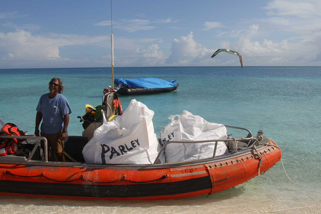 Sette small boat loaded with bagsters of marine debris to take back to the ship.