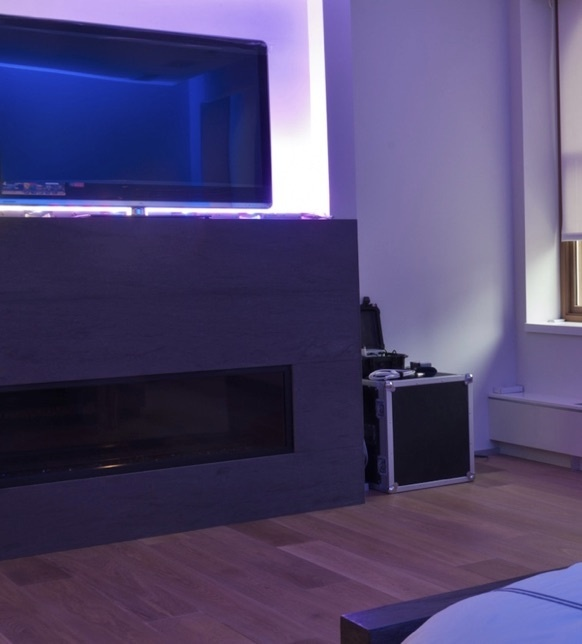 TV mounted over gas fireplace in living room