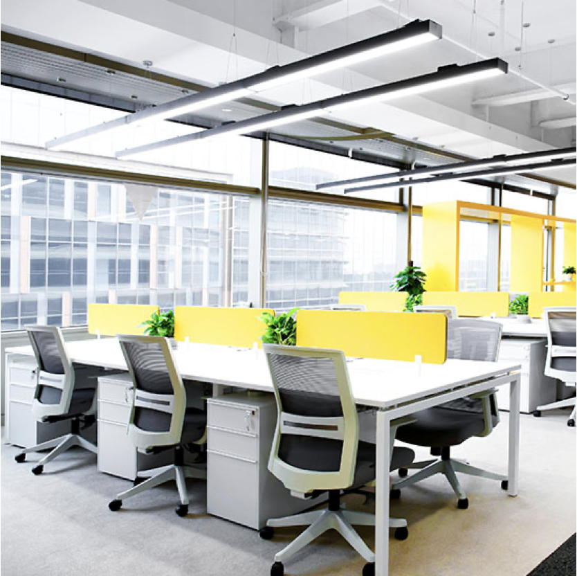Office space with a large white table and chairs with yellow accents