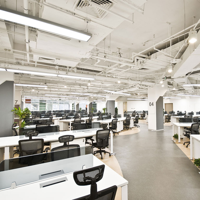 Large open office space with overhead lighting
