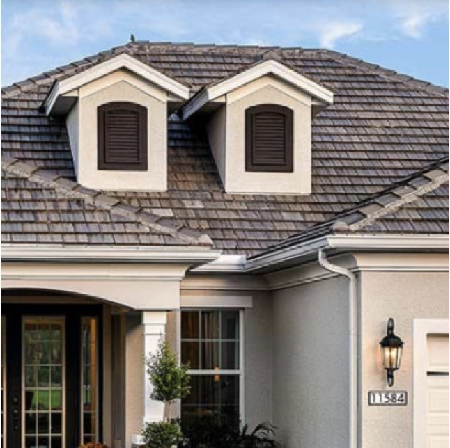 exterior of beige home with white and dark brown accents