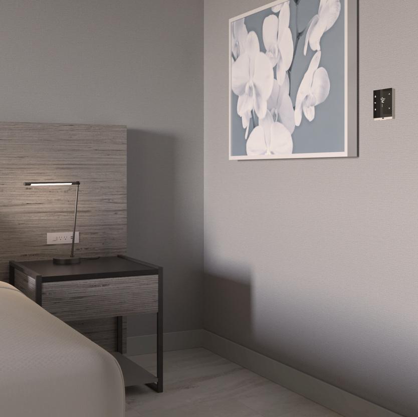 Hotel bedroom headboard view with smart lighting controls