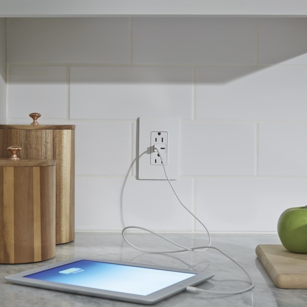 Legrand's radiant Collection USB-A/C outlet charging tablet on counter top