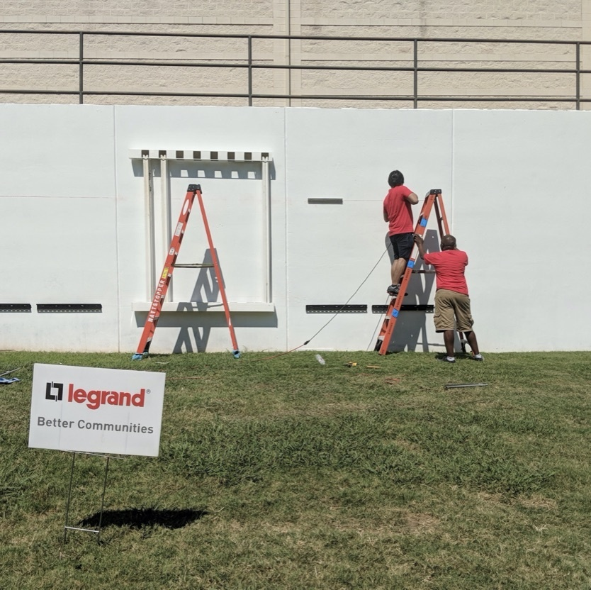 Legrand workers building new wall