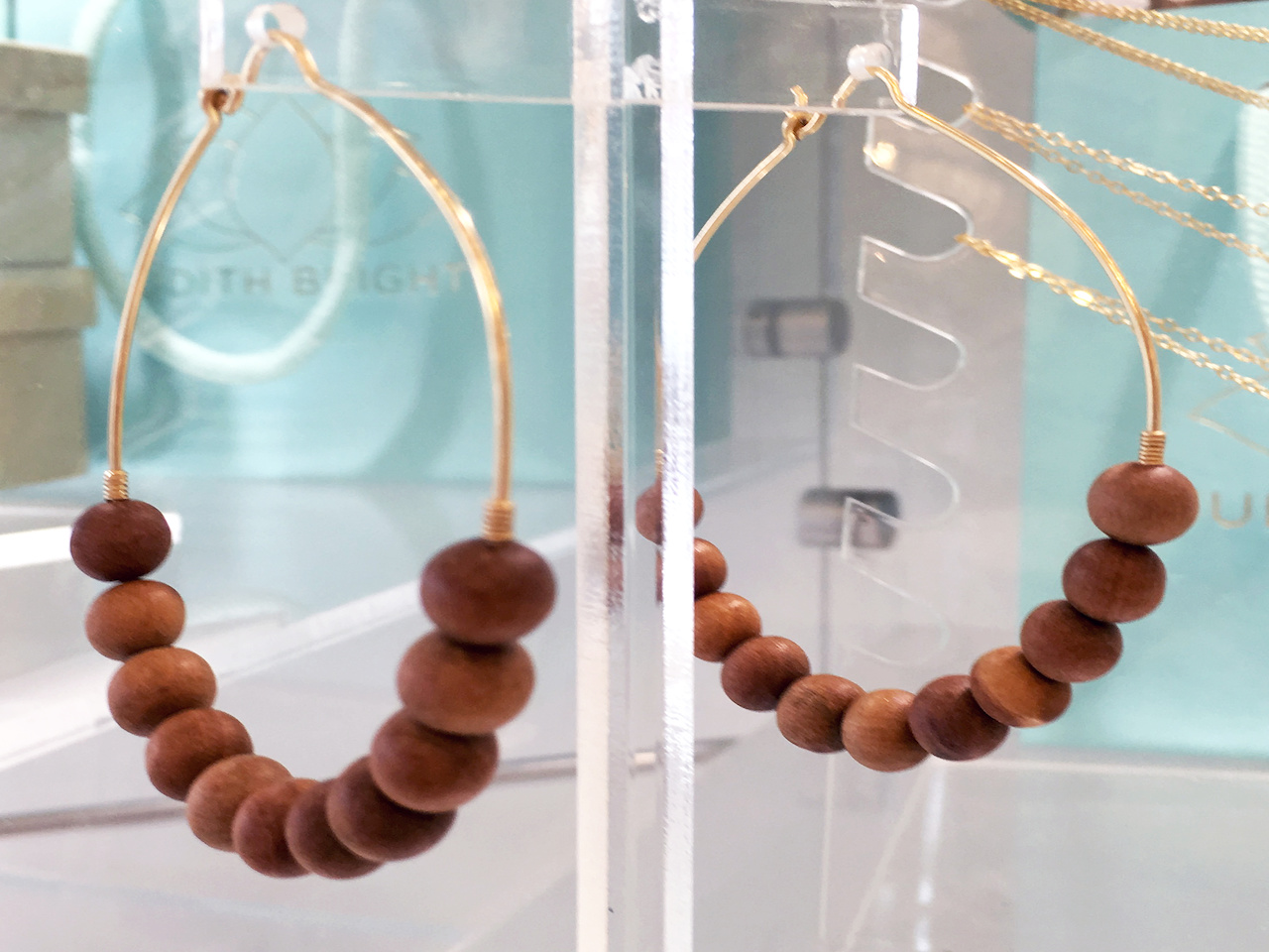 From Judith Bright: Sandalwood earrings, $98