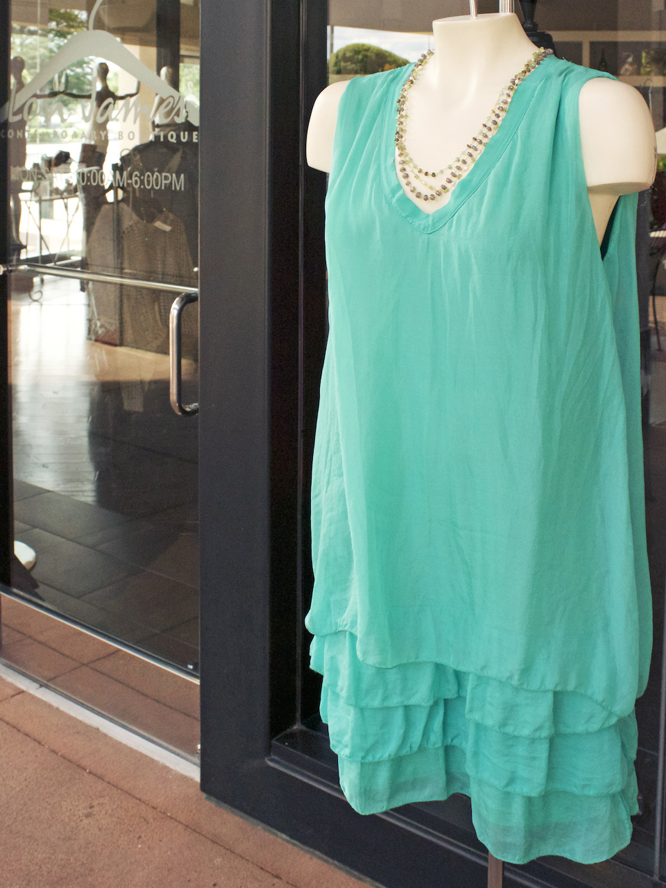 Colorful and cool, this tiered silk dress brings a pop of green into any party
