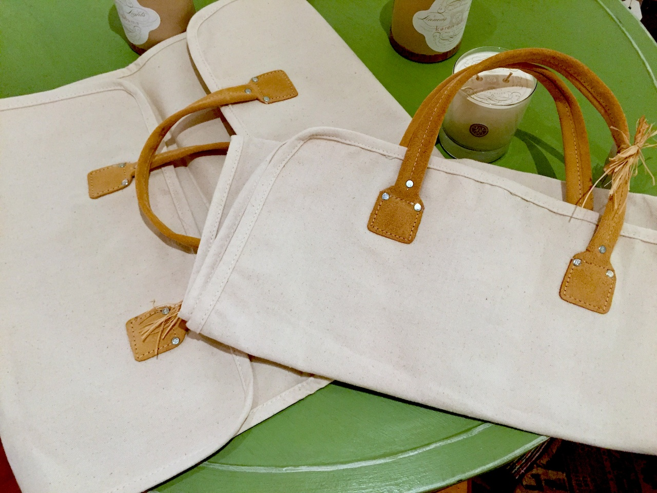 Canvas and suede log carrier, $18 at Palladio Interiors