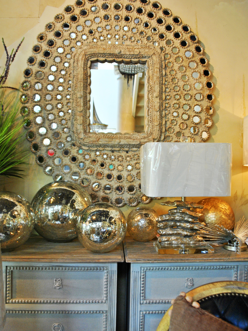 Mirrors, metallics and mercury accessories reflect the light and brighten any space.