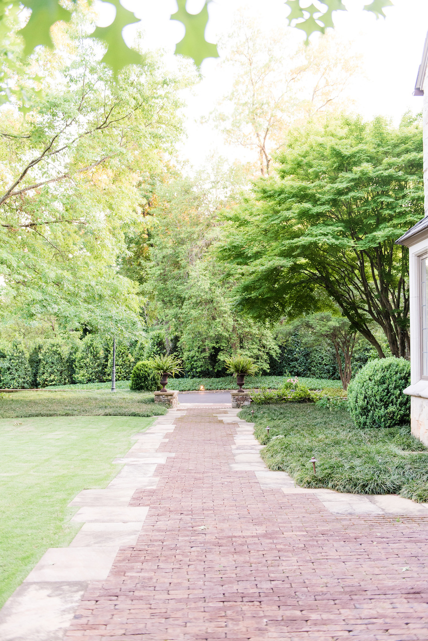 """""""The brick and stone paving was meticulously installed by Edwin Torres of Carrigan Stone,"""" says John. """"He did an incredible job of marrying the random stone edge to the running bond brick coursing pattern."""""""
