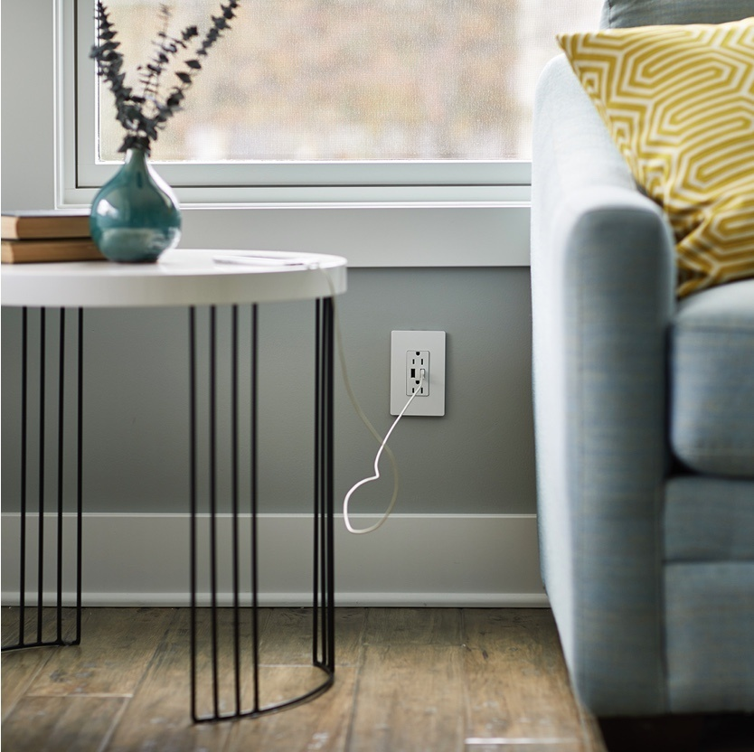 adorne Collection by Legrand Dual-USB outlet in living room with smart device charging
