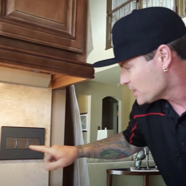 Vanilla Ice touching adorne dimmer and switch in his kitchen