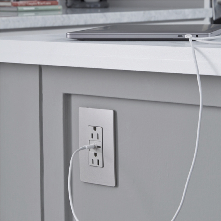 radiant Collection USB outlet in nickel installed in kitchen island