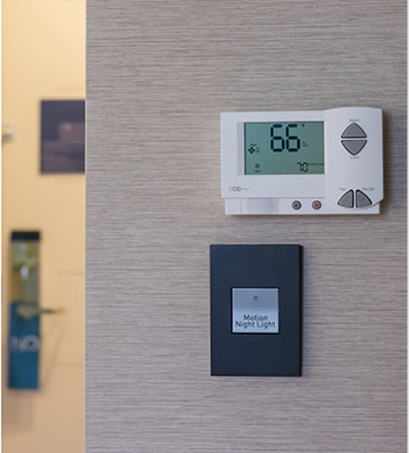 Hotel wall with temperature control and adorne lightswitch
