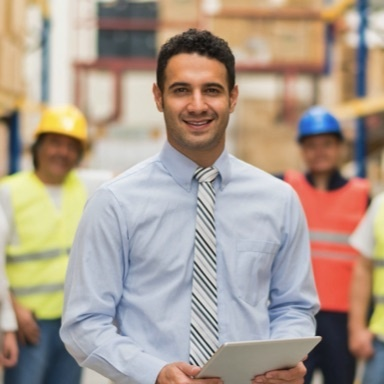 Businessman smiling standing in a warehouse
