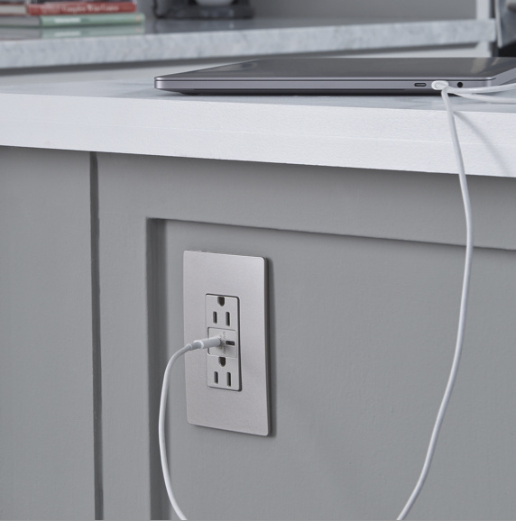 radiant usb charger in kitchen island charging iPad
