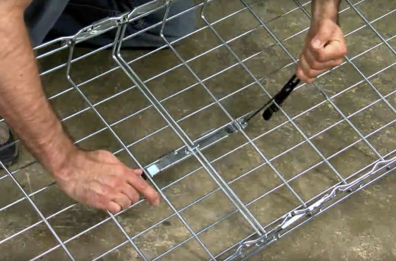 Contractor splicing sections of wire mesh cable tray