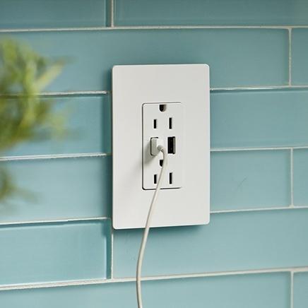 White USB outlet installed on light blue tile backsplash