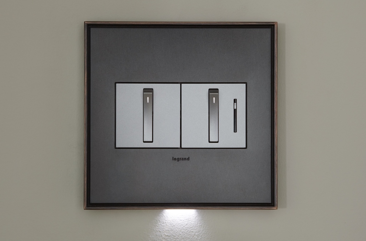 adorne Collection by Legrand whisper light switch and dimmer with accent light below