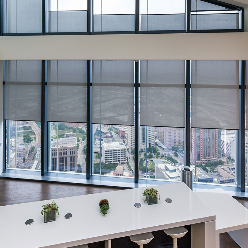 Overhead view of commercial space with shades and windows overlooking city