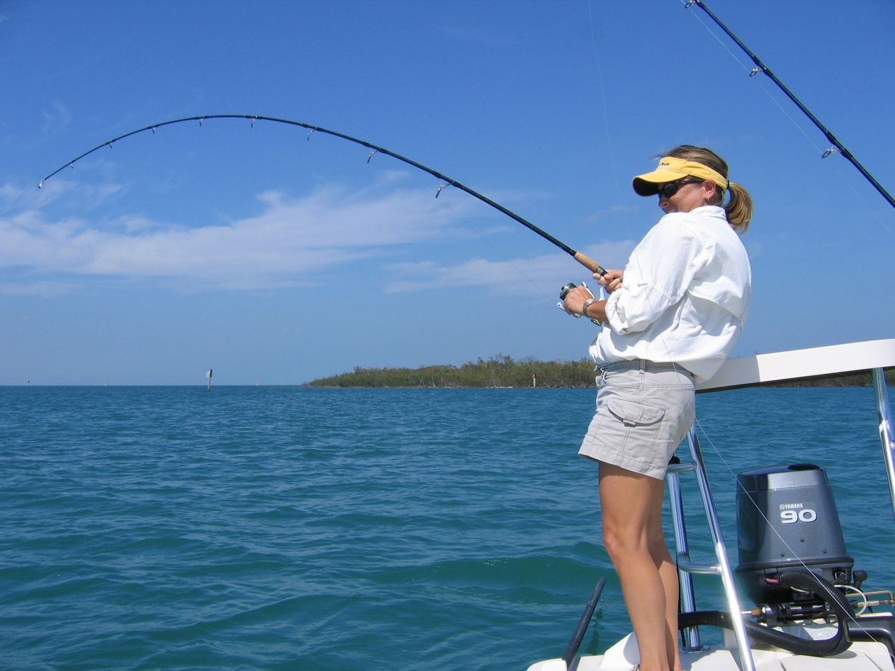 Woman fishing in Gulf of Mexico.