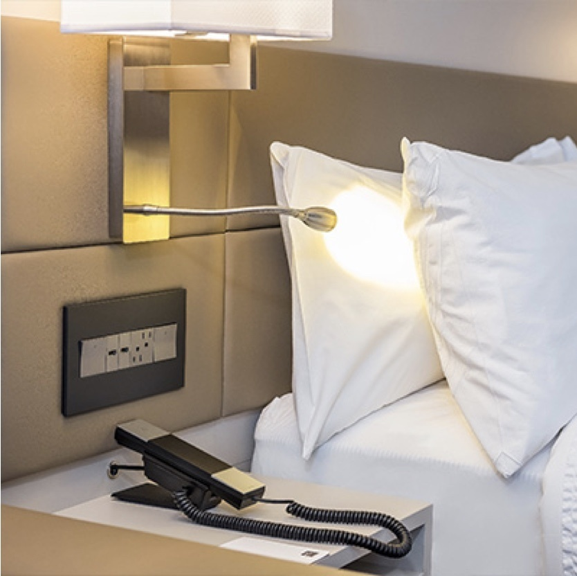 Hotel bed with adorne furniture power center in headboard