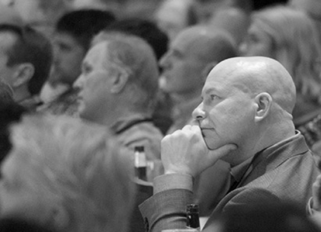 Audience listening at event