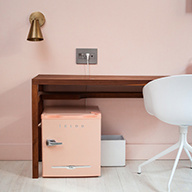 Pink room with desk and gray outlets