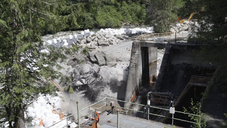 A portion of the Middle Fork Nooksack Dam being demolished