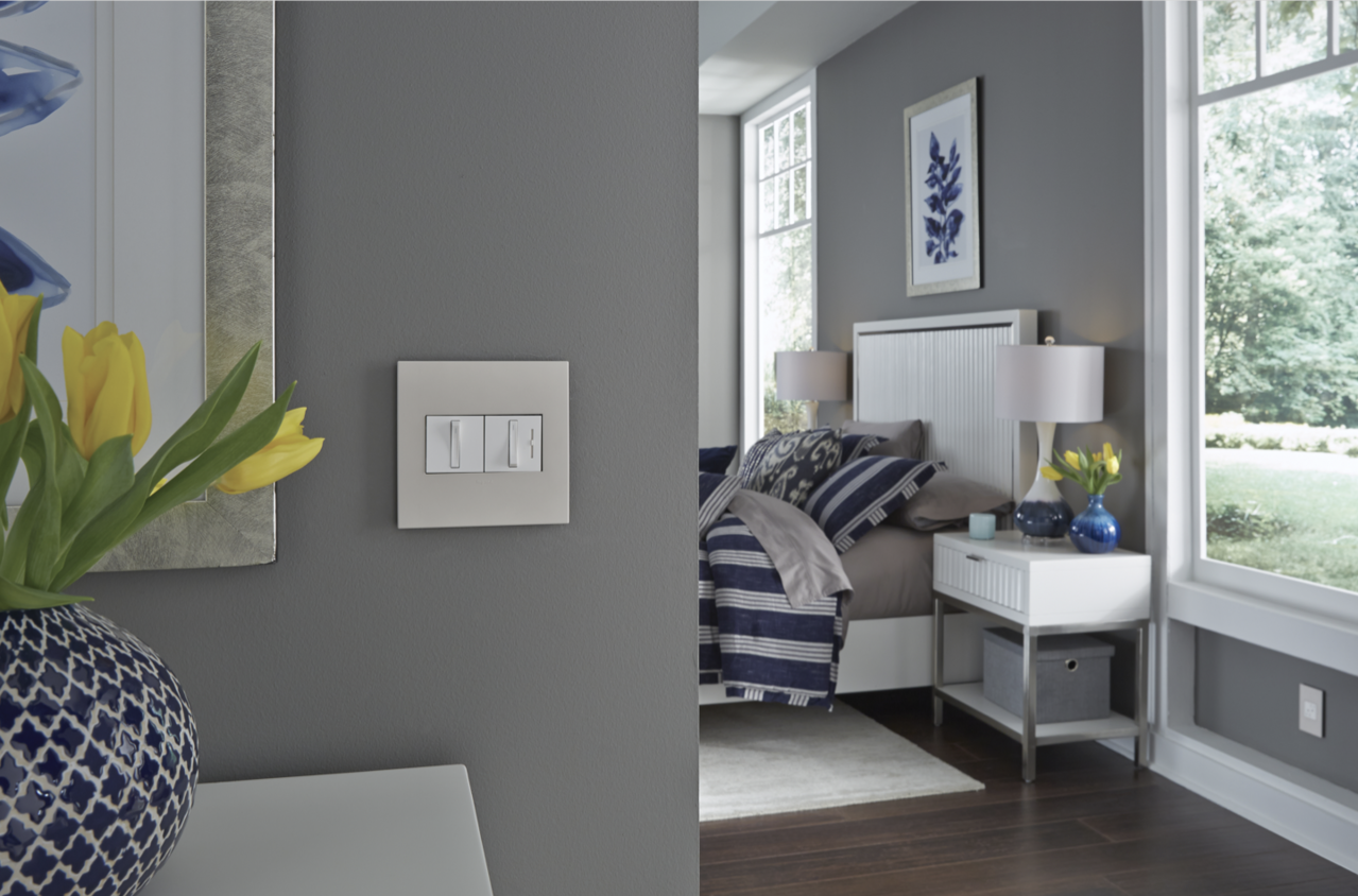 adorne Collection by Legrand Whisper light switches on light green wall next to bedroom