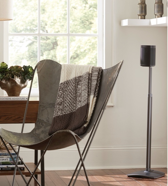 Wireless Sanus speakers near chair