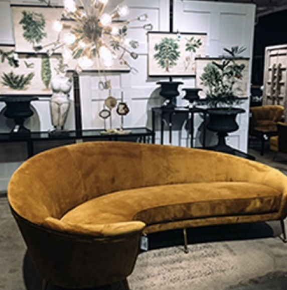 Retro circular velvet mustard couch in showroom