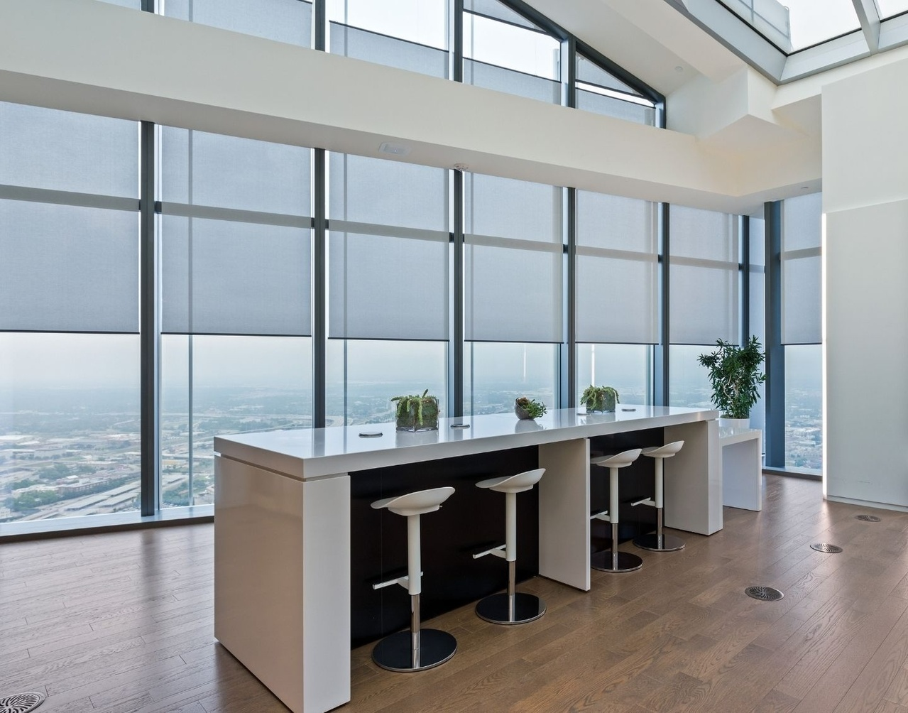 Commercial space with shades over large windows