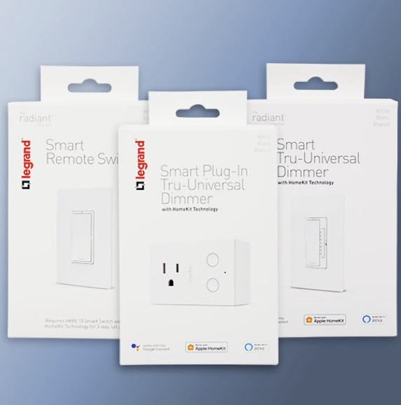 White Legrand smart switches, dimmers and plug-in dimmers packaging on blue background