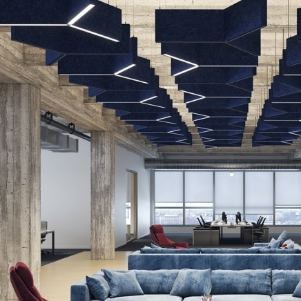 ACOUSTIC SOLUTIONS IN OFFICE BUILDING WITH BLUE CEILING AND BLUE SOFAS