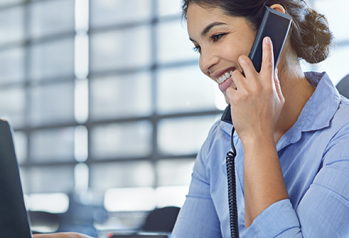 Woman on phone while speaking to customer support