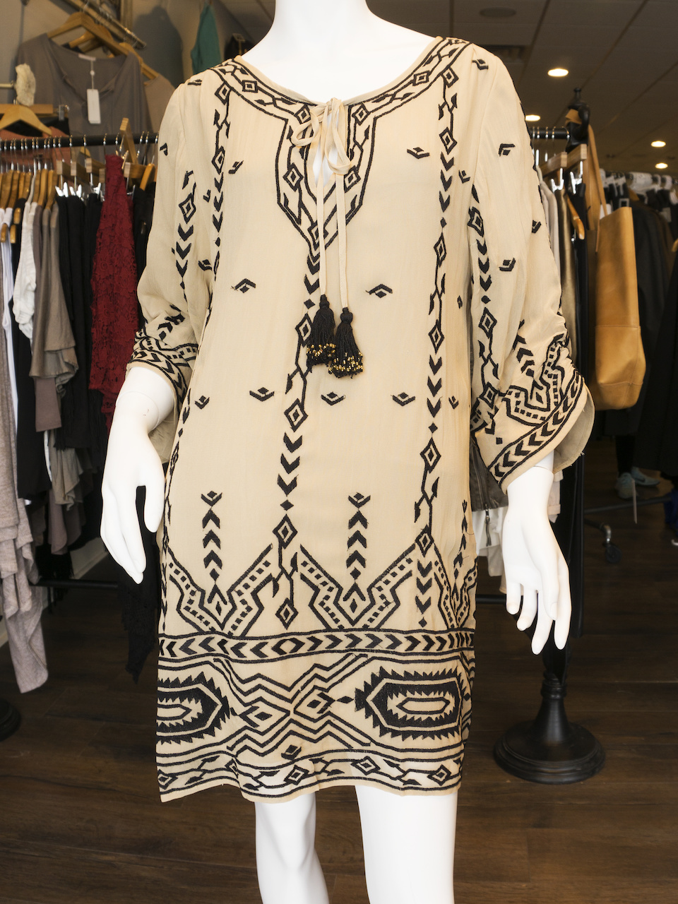 Tolani printed shift dress with tassle, $179; Black lace-up clogs, $89