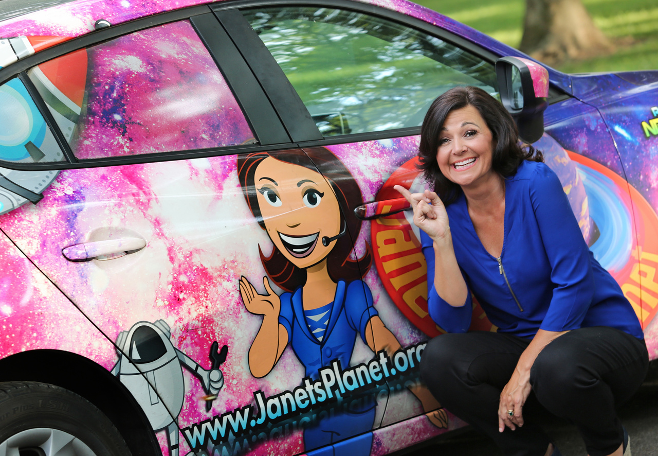 Janet is easy to spot in her specially wrapped car.