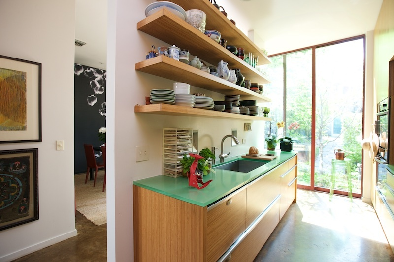The kitchen displays many of the home's eco-friendly features, such as the bamboo millwork and cabinetry and recycled resin, or three-form, serves as a countertop and backsplash in the kitchen.