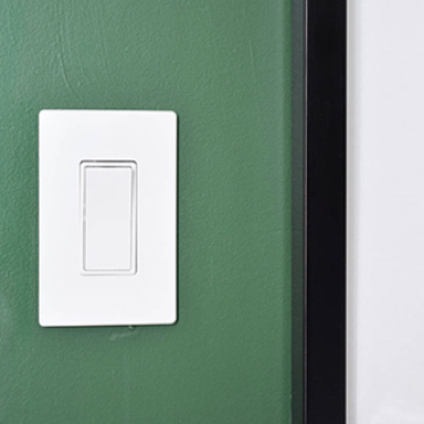 White switch on dark green wall