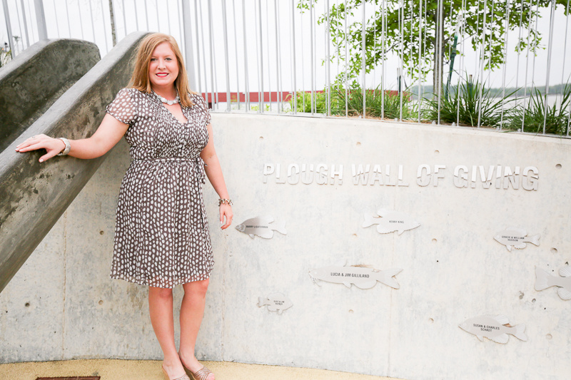 Katie at the Plough Wall of Giving at Beale Street Landing, which honors the donors who made contributed to the play area for children.