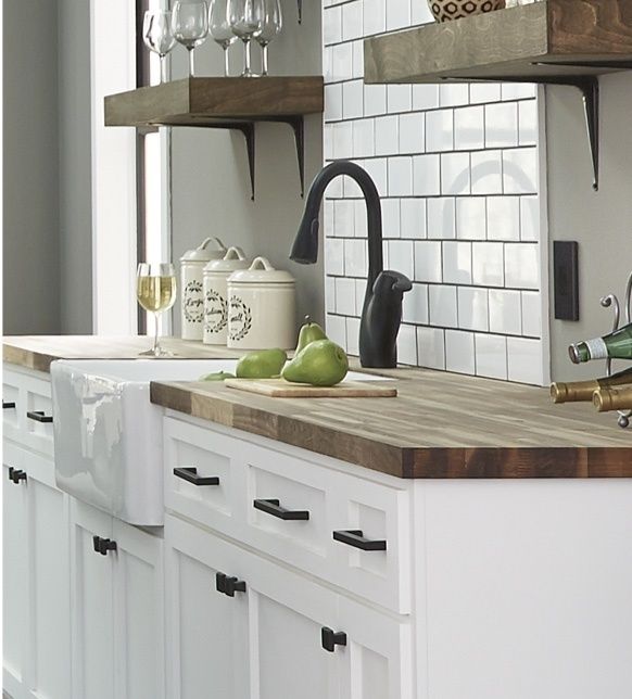 farmhouse kitchen with white cabinets and wooden counters